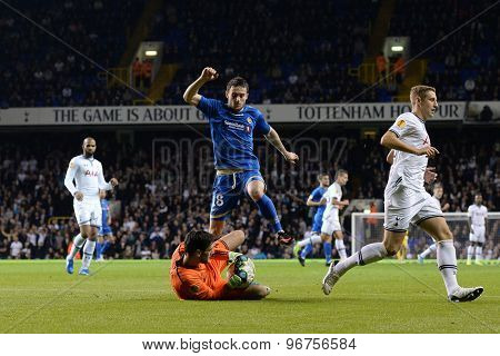 LONDON, ENGLAND - September 19 2013: Tottenham's Hugo Lloris and Tromso's Josh Pritchard  during the UEFA Europa League match between Tottenham Hotspur and Tromso played at The White Hart Lane Stadium