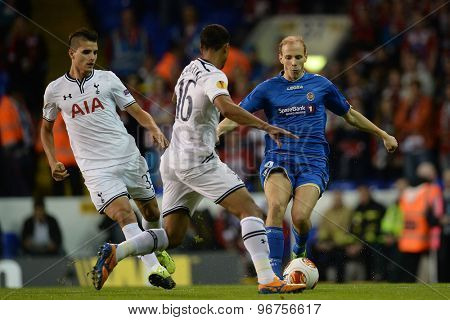 LONDON, ENGLAND - September 19 2013: Tottenham's Kyle Naughton and Tromso's Ruben Kristiansen  during the UEFA Europa League match between Tottenham Hotspur and Tromso played at The White Hart Lane