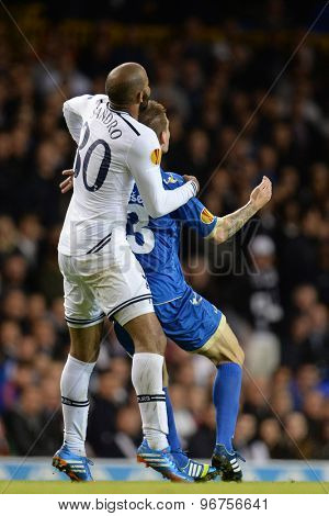 LONDON, ENGLAND - September 19 2013: Tottenham's Sandro and Tromso's Zdenek Ondrasek compete for the ball during the UEFA Europa League match between Tottenham Hotspur and Tromso