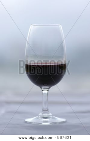 Glass Of Port Wine Against A Muted Green/Grey Background