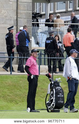 ST ANDREWS, SCOTLAND. July 15 2010: Phil MICKELSON from USA looks away as Tiger WOODS from the USA passes by on the first day of The Open Championship   played on The Royal and Ancient Old Course