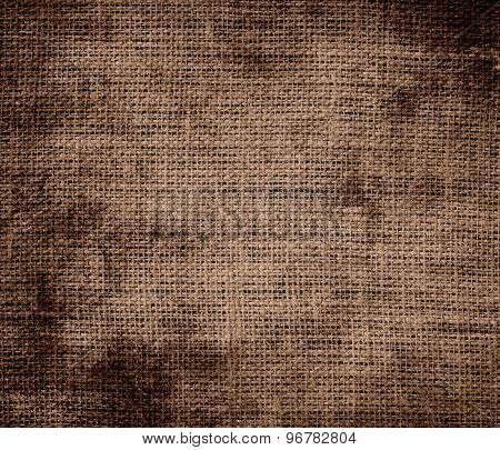 Grunge background of dark brown-tangelo burlap texture