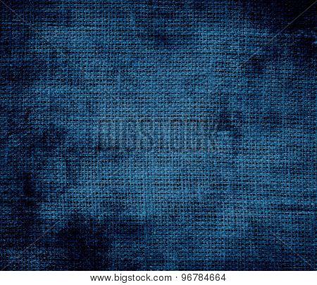 Grunge background of dark imperial blue burlap texture