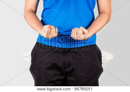 Teenager with empty pockets holding his fist in frustration