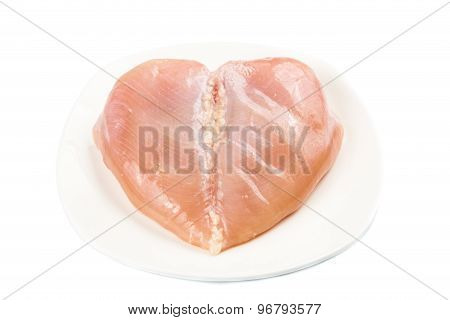 Fresh heart shaped skinless chicken breast meat on a plate