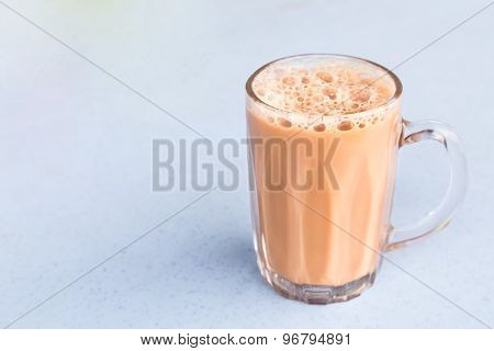 Tea with milk or popularly known as Teh Tarik in Malaysia poster