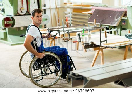 disabled worker in wheelchair in a carpenter's workshop poster