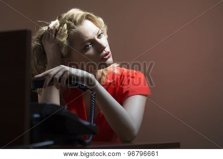 Bored Female Secretary With Phone