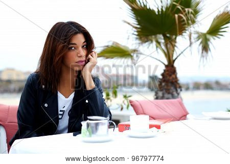 Charming fashionable afro american woman drink coffee and enjoying her recreation time at weekend