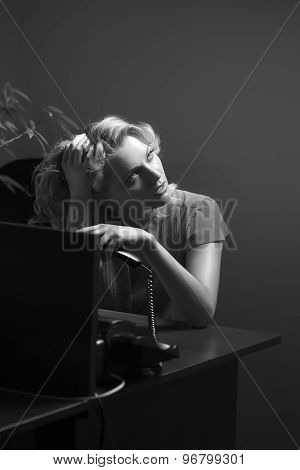 Tired Female Secretary With Phone