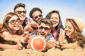 Group of multiracial happy friends having fun at beach games - International concept of summer joy and multi ethnic friendship together - Warm sunny afternoon color tones with shallow depth of field poster