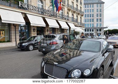 GENEVA, SWITZERLAND - SEPTEMBER 16: Four Seasons Hotel des Bergues exterior, Geneva street view on September 16, 2016. It has been a landmark on Lake Geneva since 1834