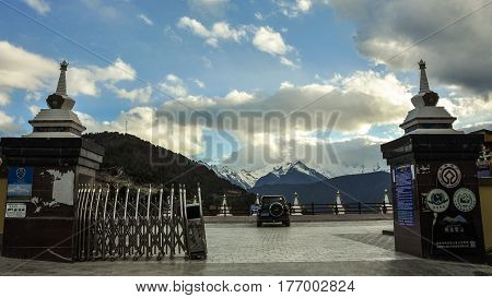 Tibetan Stupa With Snow Mountain Background