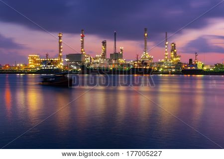 Sunrise scence of Oil Refinery factory industry with blue sky and clouds. Petrochemical plant Petroleum Industrial-plant. with reflection