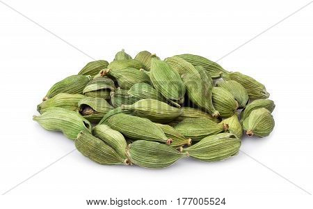 Pile of green cardamom isolated on white background. Heap of cardamon pods. Indian spice. Condiment