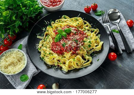 Homemade Hot Pasta with Marinara Sauce, Basil, Garlic, Tomatoes, parmesan cheese on plate
