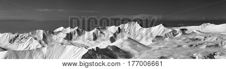 Black And White Panoramic View On Off-piste Slope And Snowy Plateau At Nice Day