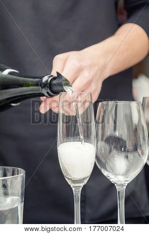 Sommelier Pouring Wine To The Wine Glass