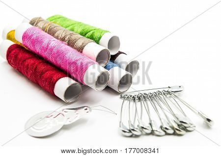 sewing tools and pins on the white background