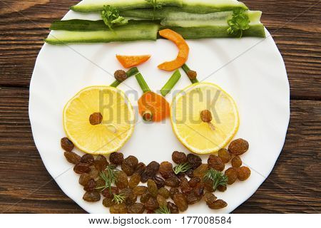 Healthy Lifestyle Concept. Vegetable Bike On Dish Over Rustic Background.