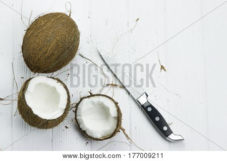 two coconut pulp fresh tropical brown white organic coconut coconut flakes milk knife
