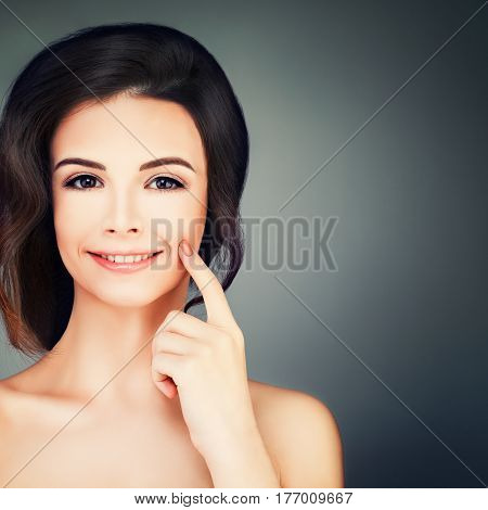 Spa Beauty. Cute Young Woman with Healthy Skin. Skincare Spa Beauty and Cosmetology Concept on Blue Background with Copy space