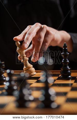 Close up image of man who is capitulating in chess game.