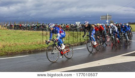 Cernay-la-Ville France - March 5 2017: The peloton taking a curve on a wet road during the first stage of Paris-Nice on 5 March 2017.
