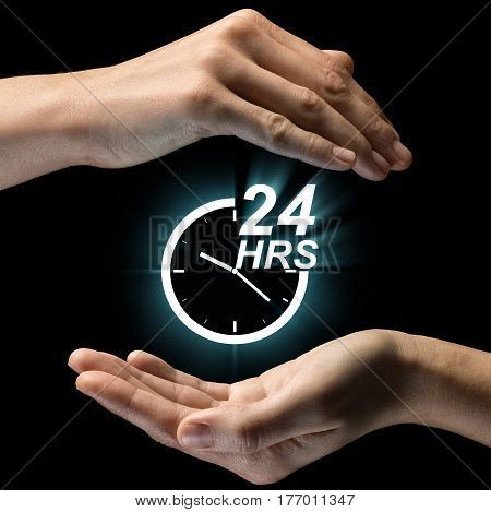 Isolated image of two hands on black background. 24-hour support service icon in the center as a symbol of constant care support. Concept of constant care support.