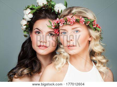 Beauty Portrait of Brunette and Blonde Women Fashion Models in Flowers Wreath