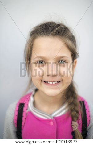 smiling child girl portrait with focus on eyes