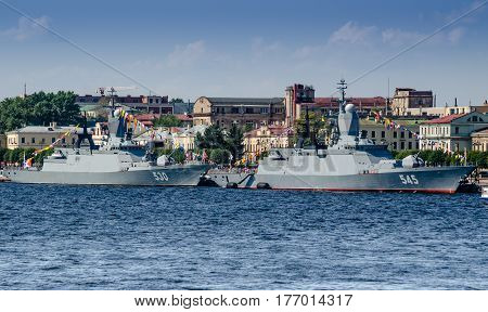 SAINT PETERSBURG, RUSSIA - 27 July 2014: two modern Corvette of the Russian Navy moored in the river Neva on for the parade in honor of Navy Day in St. Petersburg. 27 July 2014.Town in the background and blue sky.