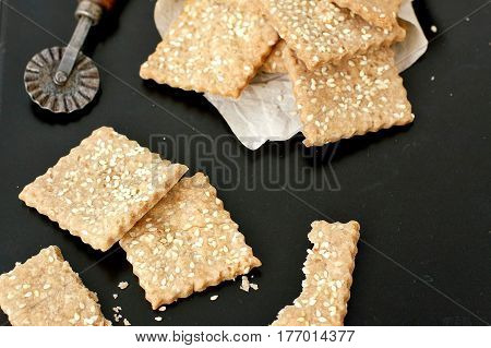 Homemade Rye Crackers With Sunflower Sesame On Black Background