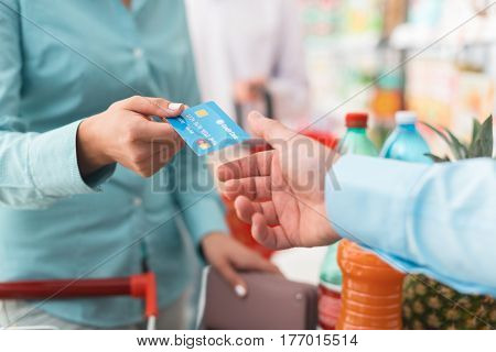 Woman At The Store Checkout