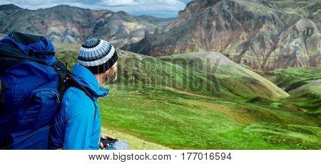 man hiker on the trail in the Islandic mountains. Trek in National Park Landmannalaugar, Iceland