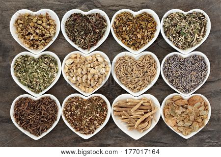 Alternative herbal medicine for sleeping and anxiety disorders in heart shaped china dishes.