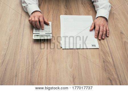 Businessman Checking Tax Forms