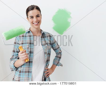 Young Woman Painting Her House