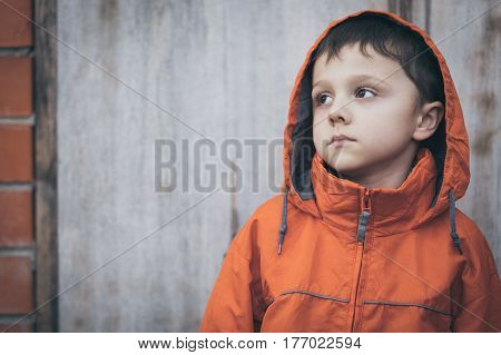 Portrait Of Sad Little Boy