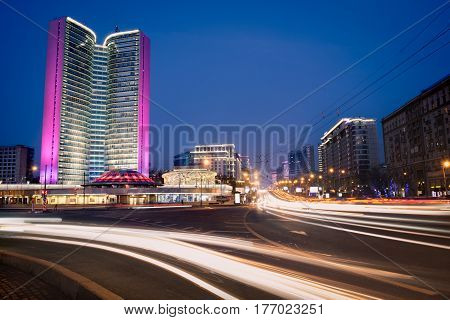 Blurred night traffic movement at the city center of Moscow urban view with skyscraper and city illumination lights outdoor travel background
