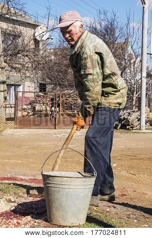 Russian Farmer With Bucket And Shovel