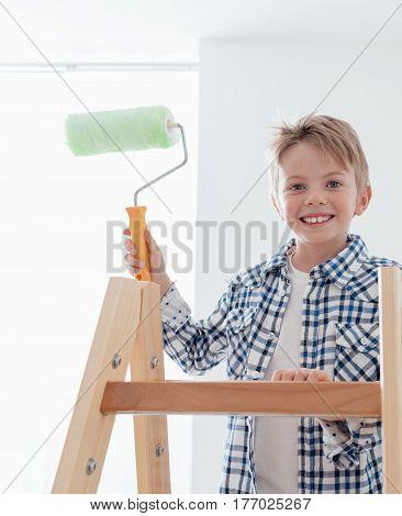 Cute Boy Holding A Paint Roller