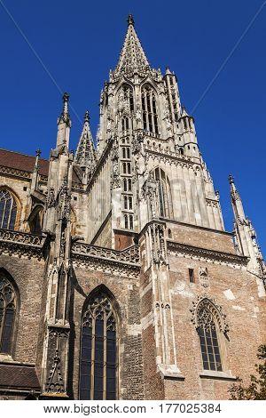 Monumental Ulm Minster and blue sky. Ulm Baden-Wurttemberg Germany.