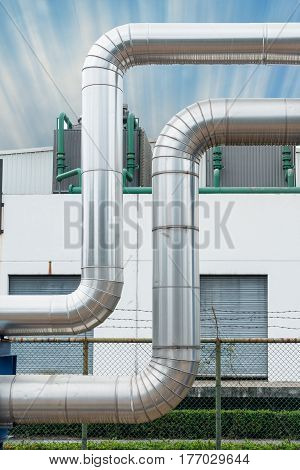 Steam distribution pipeline and insulation cover., Steam pipeline.