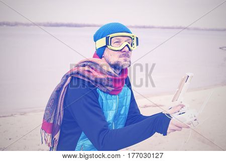Bearded Man In Goggles, Pilot With Remote Controller In Hands