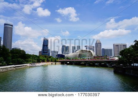 Singapore, Singapore - February 11, 2017: Singapore river near skyscrapers and Singapore Opera on sunny day in Singapore.
