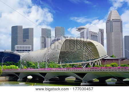 Singapore, Singapore - February 11, 2017: Singapore river near skyscrapers and Singapore Opera building on sunny day in Singapore.