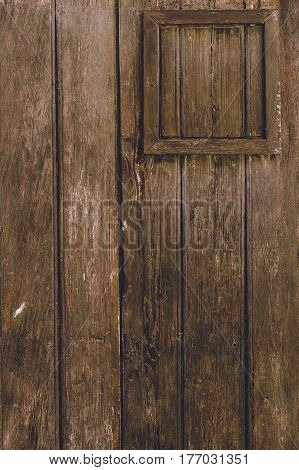 Old vintage brown wooden door, vertical composition