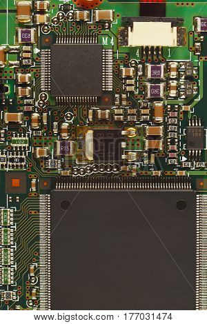 Electronic circuit board from a digital device close up.