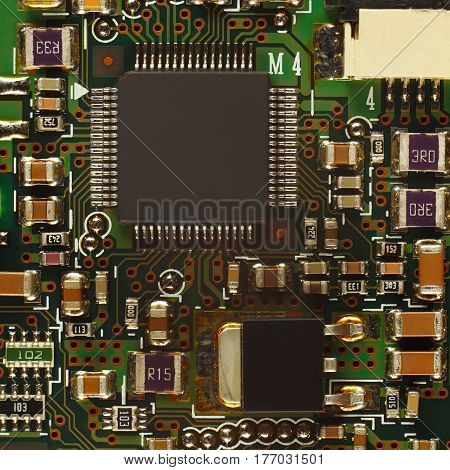 Electronic circuit board with microchips close up.